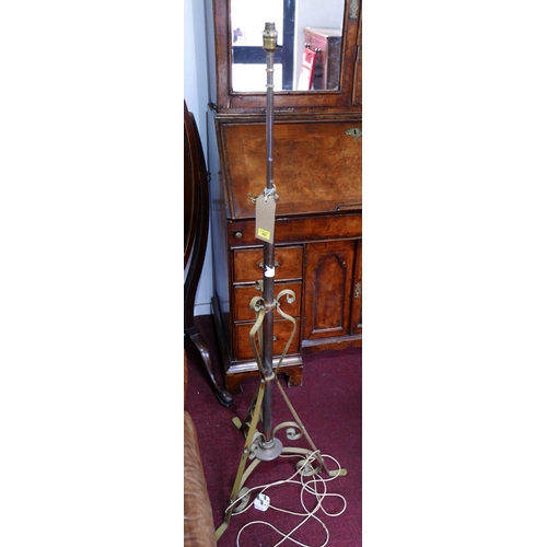 362 - A 20th century standard lamp, on tri-form scrolling base, H.150cm, with loose shade...