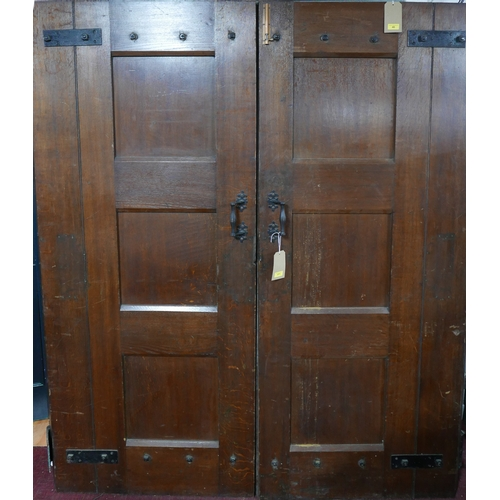 371 - A large pair of iron bound solid oak doors, H.214 W.86 D.6cm...