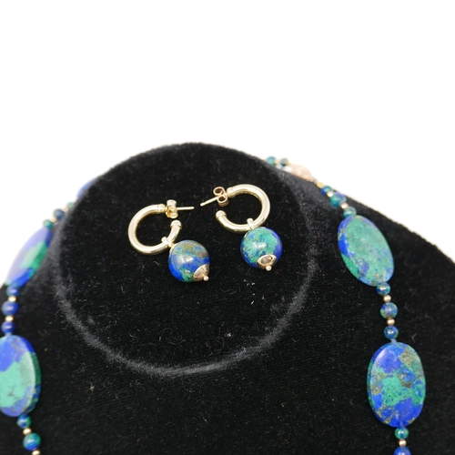 1149 - A 14ct yellow gold and Azurite necklace composed of eleven, polished, oval Azurite beads and 14ct ye...