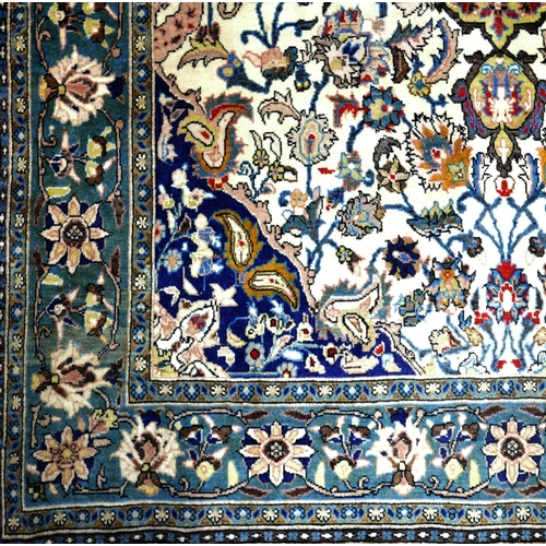 77 - A Central Persian Qum rug, double pendent medallion with repeating stylised petal motifs on an ivory...