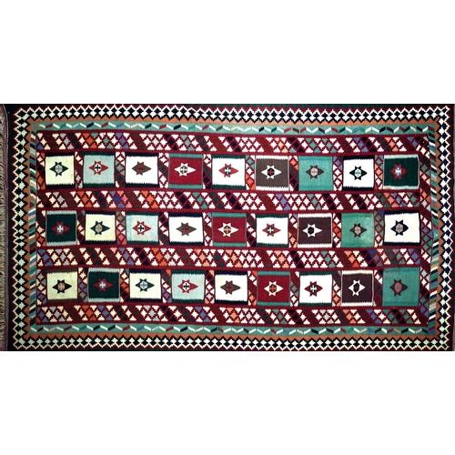 79 - A South West Persian Qashgai kilim, repeating stylised geometric motifs with stylised geometric bord...