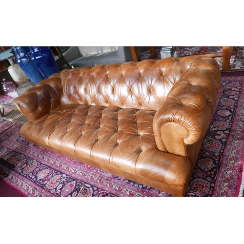 91 - A John Lewis tan leather chesterfield sofa, H:69cm, W:214cm, D:105cm...