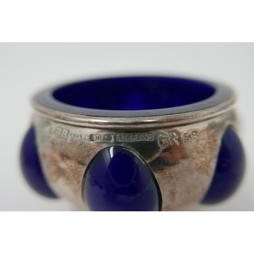 1192 - A sterling silver bowl with blue glass fitted interior, H: 5, Dia: 8cm....