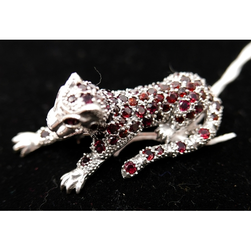 10 - A large sterling silver leopard brooch pave-set with garnets (in the Cartier style), 5.5 x 2 x 2cm, ...