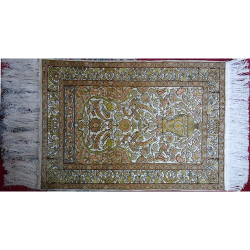 31 - A 20th century fine pure silk Turkish Hereke rug, signed by maker, with vase of flower design, on a ...