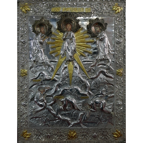 37 - A Russian white metal icon, the oklad depicting Jesus flanked by two saints, parcel gilded and with ...