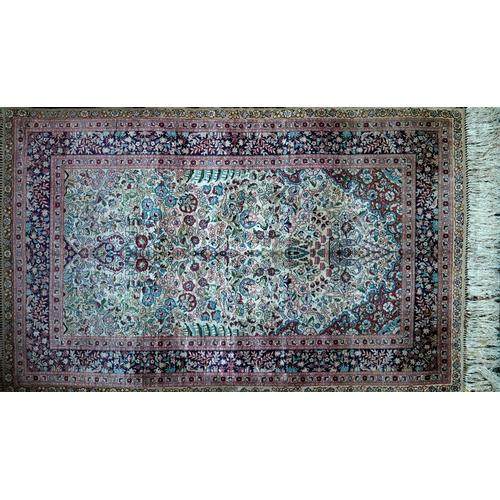 44 - A 20th century fine pure silk Turkish Hereke rug, with vase of flowers below chandelier design, surr...