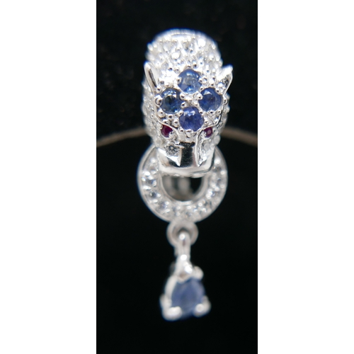 45 - A pair of sterling silver panther-head earrings, pave-set with sapphires and white crystals (in the ...