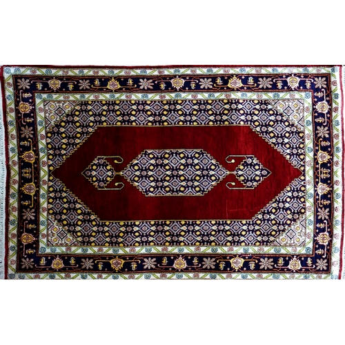 49 - A 20th century fine silk Tabriz rug, with Mahi design on a red and blue ground, 140 x 90cm...