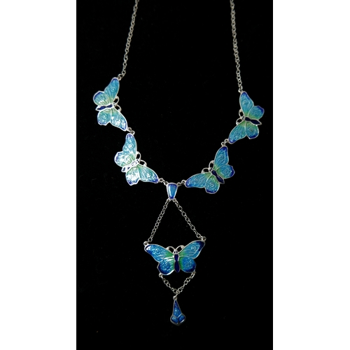 52 - A sterling silver and enamelled buttefly drop necklace in shades of turquoise and navy blue enamel, ...