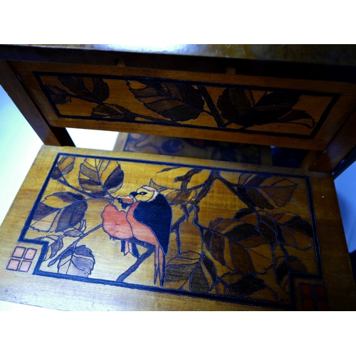 107 - An Arts & Crafts walnut three tier side table, inlaid with images of parrots, signed with initials M...
