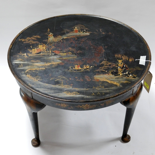 122 - A 1920's black lacquered Chinosserie coffee table, H.42 Diameter 67cm...