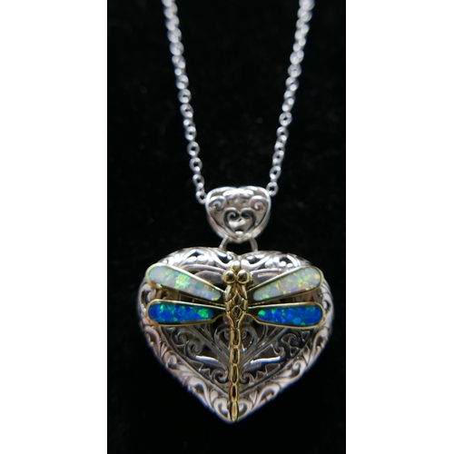 135 - A sterling silver heart-shaped pierced pendant, adorned with a dragonfly inset with opalites on a si...