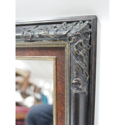 166 - A 20th century wall mirror, with scrolling foliage decoration, 62 x 49cm...