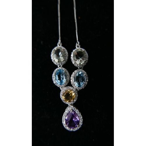 167 - A sterling silver and gem-set drop necklace set with faceted amethyst, crystal, citrine, blue topaz ...
