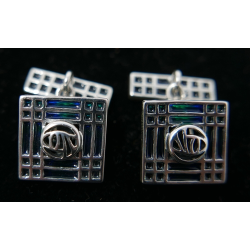 173 - A pair of sterling silver and blue/green enamel cufflinks in the Glasgow style, Gross: 12.4g....