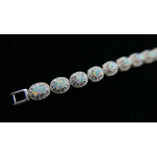 178 - A sterling silver, opalite and white crystal cluster bracelet, L: 18.5cm, 16.8g....