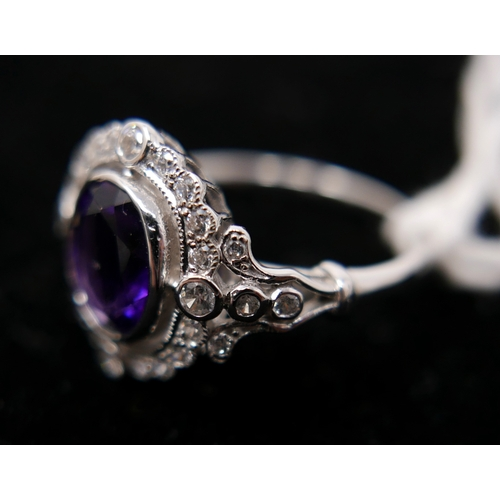189 - A sterling silver, amethyst and white sapphire cluster ring, Size: N, 3g....