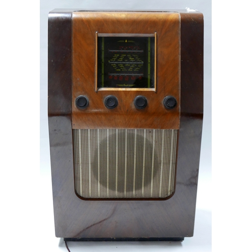 192 - An early 20th century floor standing Bush radio in walnut case, H.83 W.51 D.28cm...