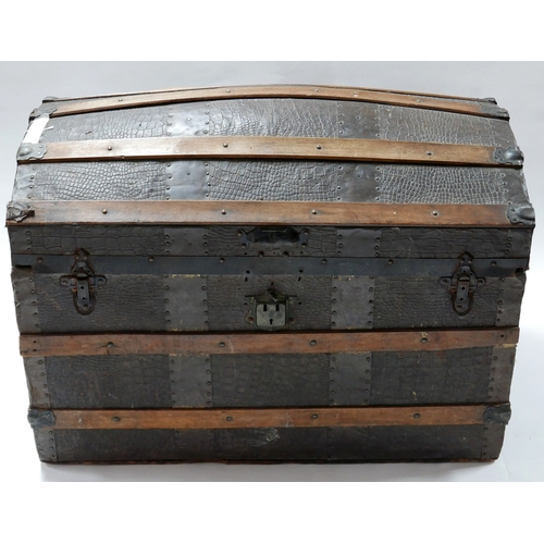 261 - An antique iron bound faux crocodile skin dome top trunk, H.57 W.81 D.50cm...