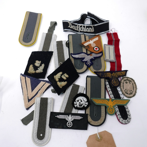 370 - A collection of Third Reich and reproduction cloth badges and shoulder straps (qty)...