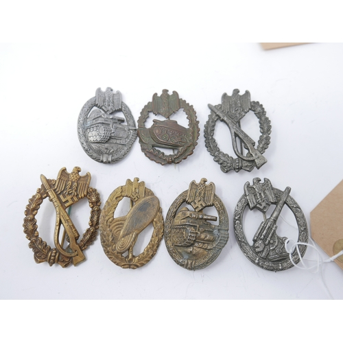 163 - A collection of reproduction Third Reich badges, including two Infantry Assault badges, a Wehrmacht ...