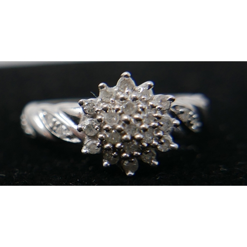 17 - A 9ct white gold and diamond cluster ring of floral design, hallmarked...