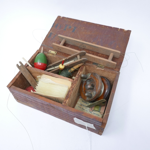 174 - A collection of fishing tackle in a wooden box...