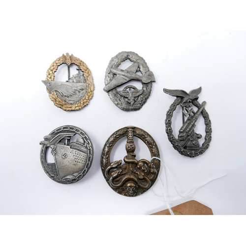 180 - A collection of five reproduction Third Reich badges, to include Naval, Artillary and Luftwaffe and ...