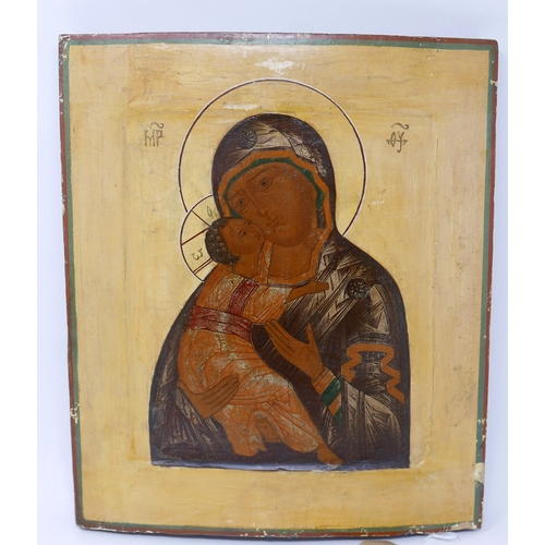 19 - A Russian icon of the Vladimirskaya Mother of God, tempera on wood panel, 30 x 27cm...