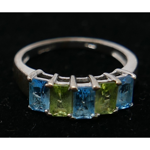 20 - A 9ct white gold five stone ring, set with cushion cut aquamarine and green gemstones...