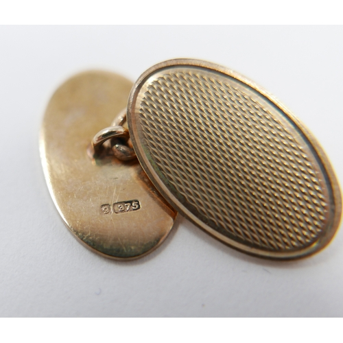 26 - A pair of 9ct gold cufflinks, with engine turned design, hallmarked Birmingham, makers mark D&B...