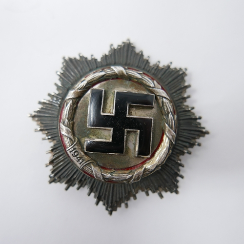 125 - A Reproduction Third Reich 1941 War Order of the German Cross in white metal, 6 x 6cm...