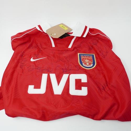 114 - A 1990's signed Arsenal football shirt...