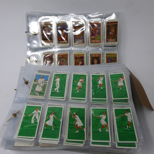 58 - A collection of vintage cigarette card sets in plastic sleeves...