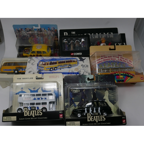 97 - A collection of six Beatles Corgi toys in original boxes...