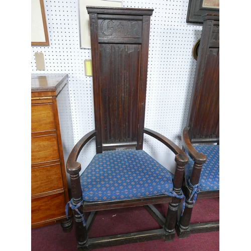 102 - A pair of late 19th century oak high back gothic throne style armchairs, the toprails each carved wi...