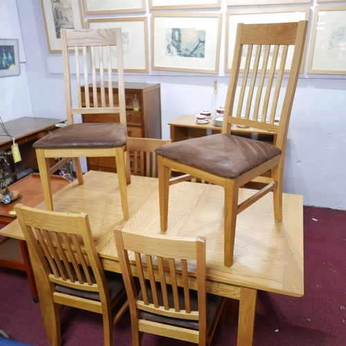 119 - A collection of John Lewis oak furniture, to include a table, two side tables and five chairs...