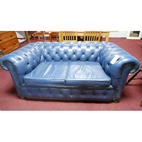 196 - A blue leather Chesterfield sofa...
