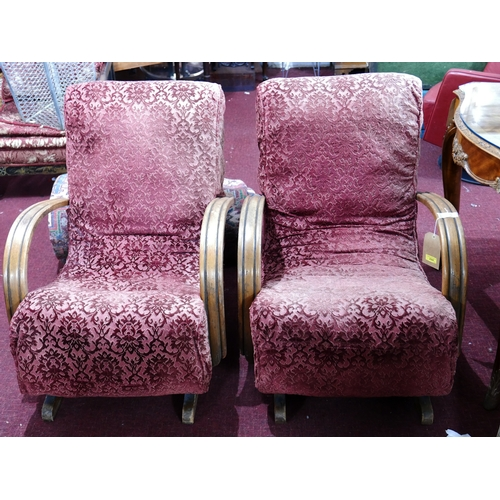 224 - A pair of Art Deco rocking chairs with lockable movement...