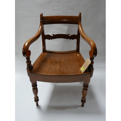 234 - A 19th century teak scroll arm desk chair...