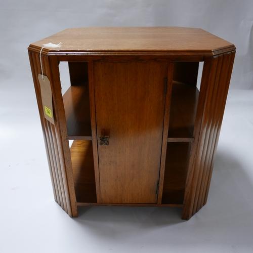 242 - An Art Deco oak low table with cupboard door, H.54 W.51 D.51cm...