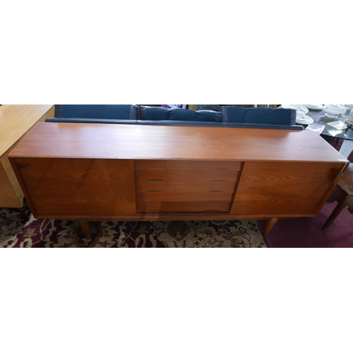 279 - A mid 20th century Dyrlund Danish teak sideboard, with two sliding doors enclosing five central draw...