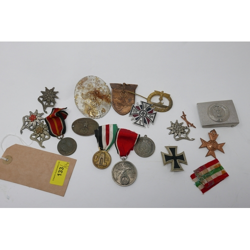 133 - A collection of reproduction Third Reich badges, medals, and plaques, together with a Soviet style b...