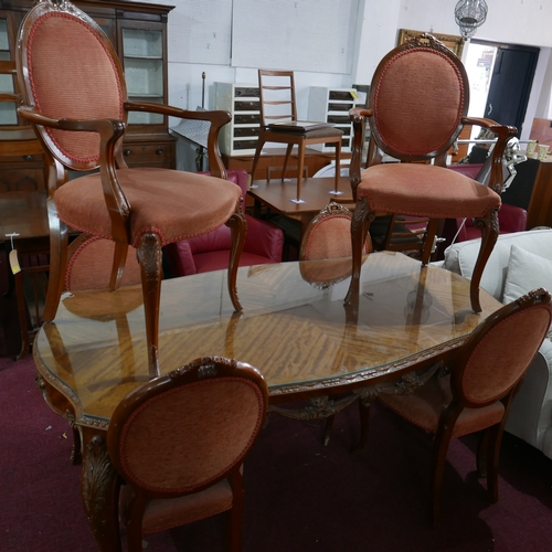 273 - A 20th century French walnut dining table and six chairs...