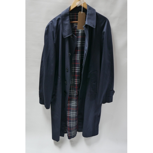 51 - A Burberry navy blue cotton overcoat, in excellent condition, XL...