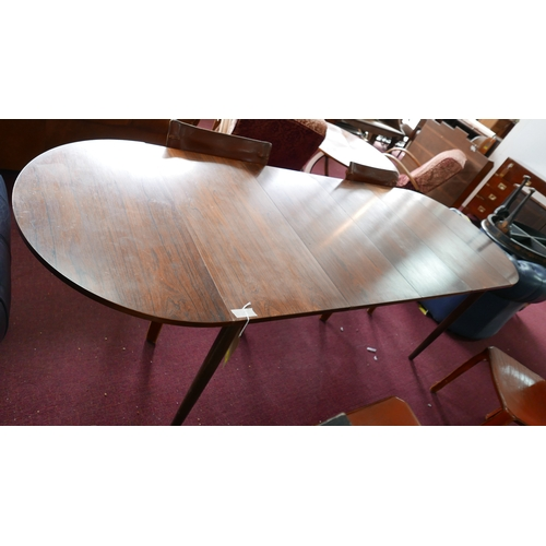 120 - A mid 20th century N&R Mobler Danish exotic hardwood D-end dining table, with 2 leaves, removable en...