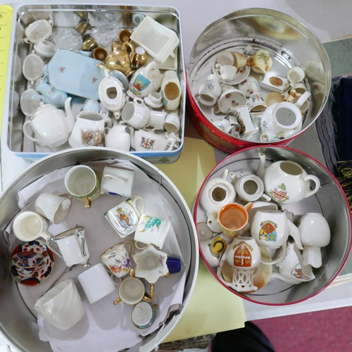 355 - A collection of miniature porcelain in three tin boxes...