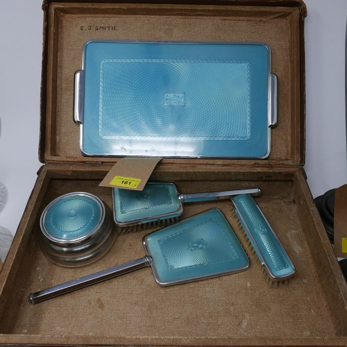 161 - A vanity set, with faux enamel decoration, including a tray, mirror, dish and cover, and two brushes...