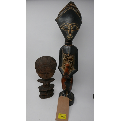 179 - An African carved tribal reliquary figure, H.27cm, together with an ebonised tribal figure, H.52cm (...